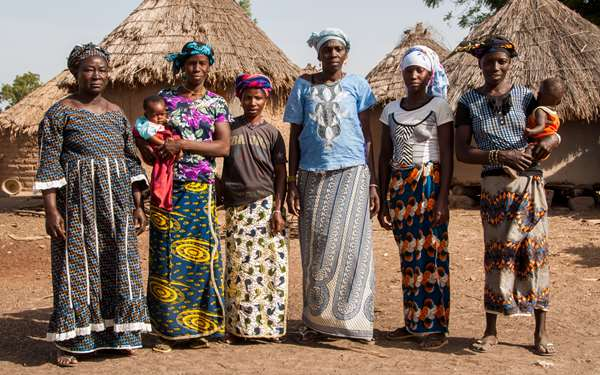 Women that will be supported through the She Grows project standing in their village.
