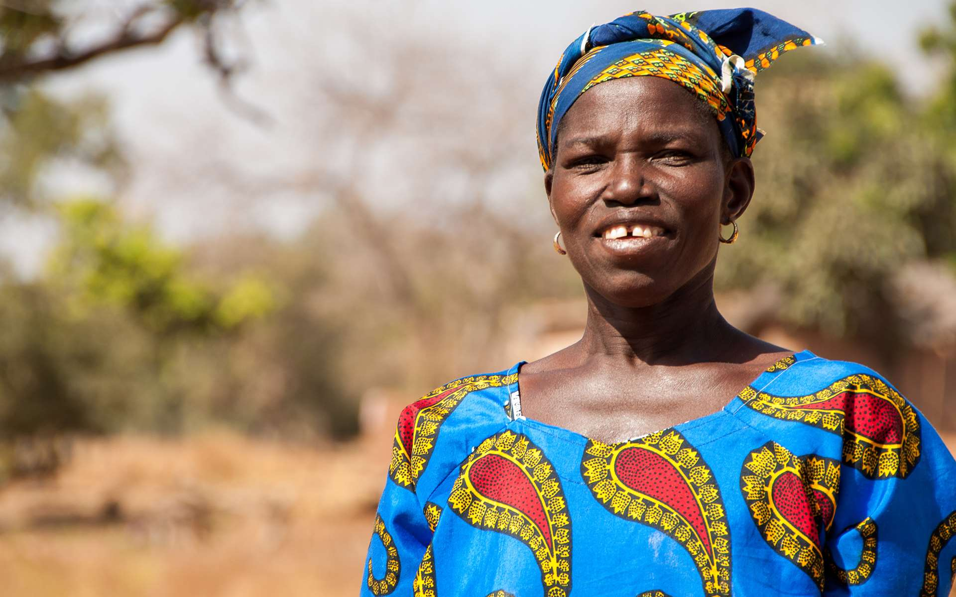 Close up of Naomie, a woman in Mali that is participating in a Tree Aid project.