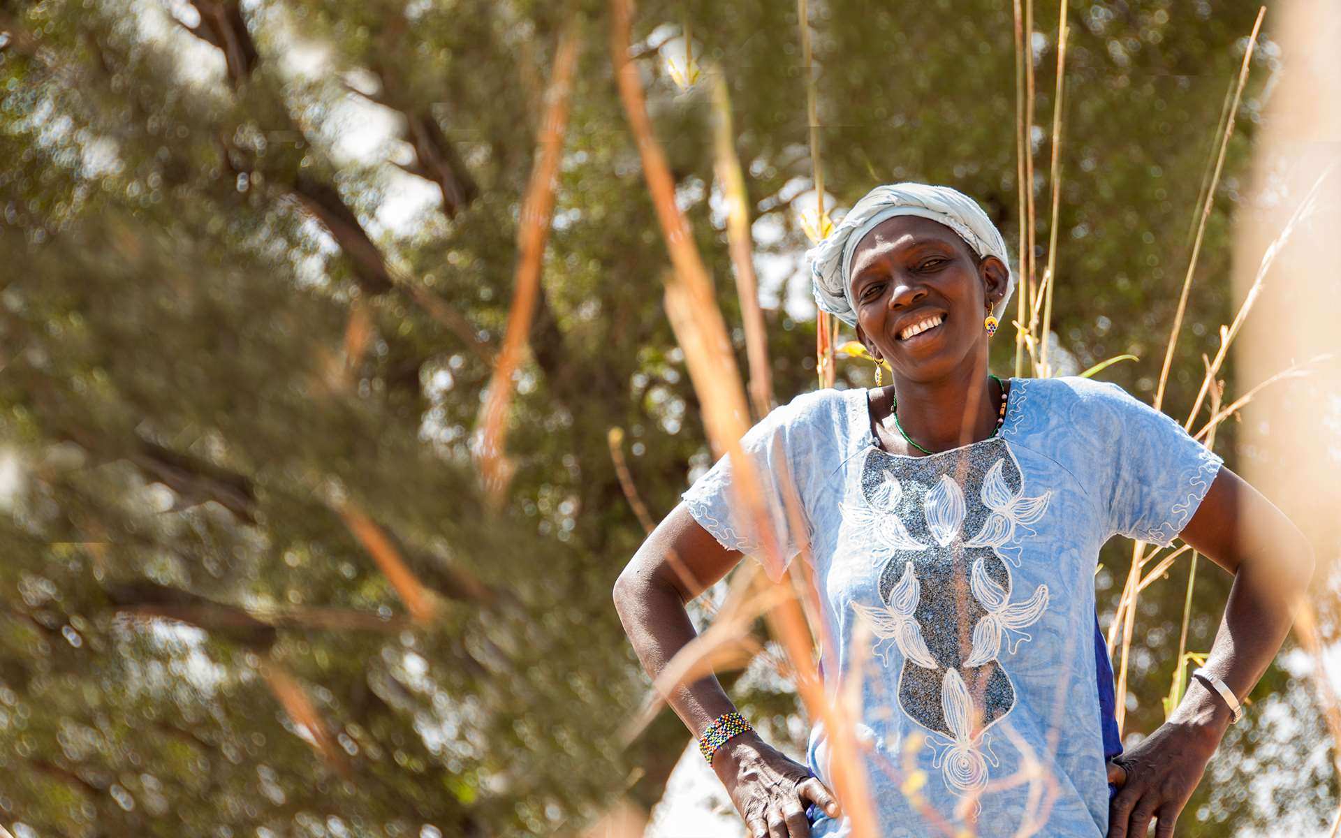 Setou, a member of Tree Aid's She Grows project, smiling.