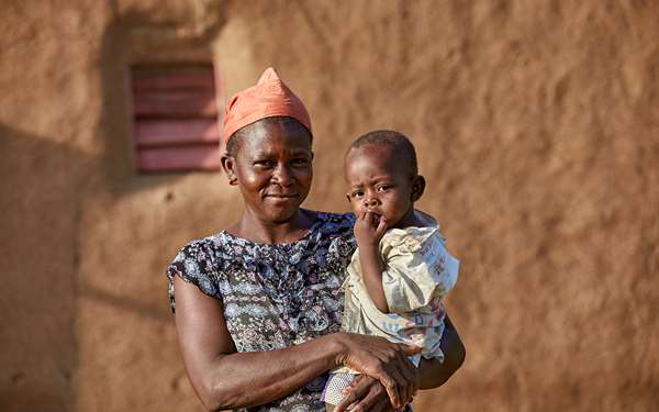 Kachana, a woman we are working with in Ghana, holding her one-year old son, Faustus