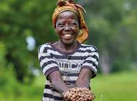 Katumos, a member of Katiu village shea group, holding shea nuts in her village in Ghana